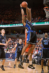 Duke guard/forward Gerald Henderson (15) grabs a rebound from Virginia forward/center Ryan Pettinella (34).  The Virginia Cavaliers men's basketball team fell to the #6 Duke Blue Devils 86-70 at the University of Virginia's John Paul Jones Arena in Charlottesville, VA on March 5, 2008.