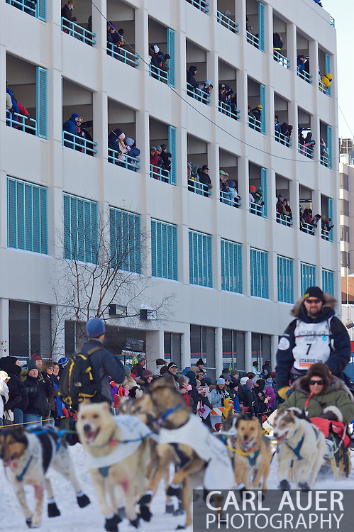 March 7th, 2009:  Anchorage, Alaska: The fans pack a 4th Avenue Parking Garage to get a view of the Iditarod Start as Warren Palfrey of Yellowknife, Northwest Territories, Canada makes his way down 4th Avenue.