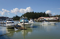 Boats docked along Swinomish Channel, La Conner Washington