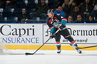 KELOWNA, CANADA - DECEMBER 5: Madison Bowey #4 of Kelowna Rockets skates behind the net with the puck against the Prince George Cougars on December 5, 2014 at Prospera Place in Kelowna, British Columbia, Canada.  (Photo by Marissa Baecker/Shoot the Breeze)  *** Local Caption *** Madison Bowey;