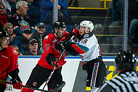 KELOWNA, BC - DECEMBER 30: Rhett Rhinehart #27 of the Prince George Cougars gets in the face of Michael Farren #16 of the Kelowna Rockets during second period at Prospera Place on December 30, 2019 in Kelowna, Canada. (Photo by Marissa Baecker/Shoot the Breeze)