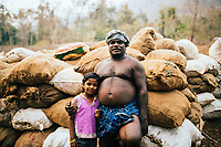 Neriamangalam, India -- February 17, 2018: A proud father poses with his daughter at his ginger fields along the Periyar river.