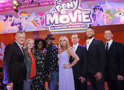 MY LITTLE PONY: The Movie stars Uzo Aduba, third left, Taye Diggs center left, and Tara Strong, center, join Hasbro's Chairman and CEO, Brian Goldner, right, Hasbro Studios Executive Vice President, Chief Content Officer Stephen Davis, left, President of Hasbro, John Frascotti, center right, and Co-Heads of Storytelling for Hasbro, Meghan McCarthy, second left, and Josh Feldman, second right, Monday, Feb. 20, 2017, in New York, at the Hasbro Entertainment Preview Event.  MY LITTLE PONY: The Movie will be in theatres October 6, 2017. (Photo by Diane Bondareff/Invision for Hasbro/AP Images)