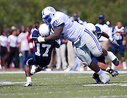 "Hampton University senior Kenrick Ellis (97) sacks Howard University Quarterback Casey Council (17) during their 31 - 21 victory in ""The Battle of the Real HU's"" held at Green Stadium on the campus of Howard University in Washington, DC.  (Photo by Mark W. Sutton)"