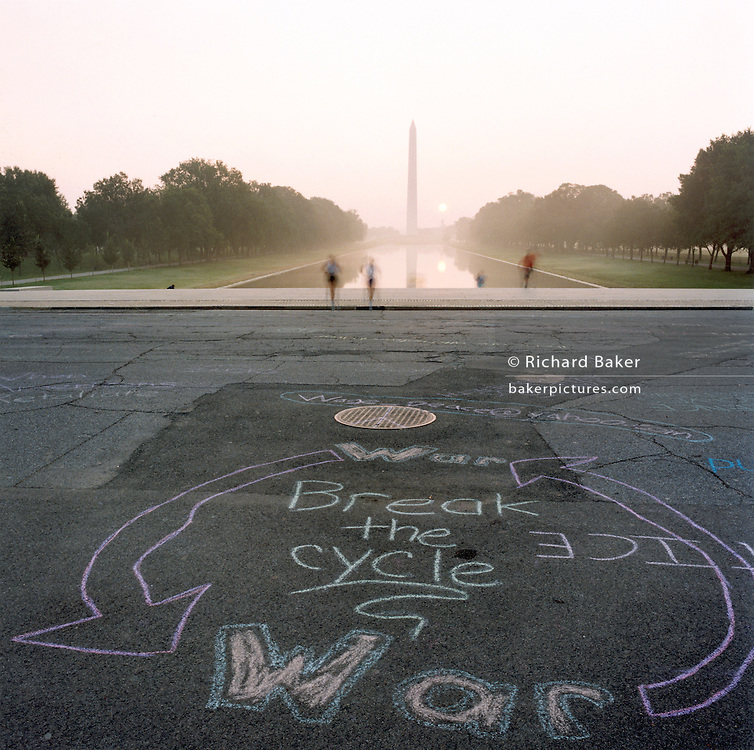 "Anti-war graffiti at the Lincoln memorial, Washington DC..Patriotic Americana - After 9/11. Chalked anti-war graffiti on the pavement near the Lincoln Memorial. In the week after the September 11th attacks, America sought to express their anger and patriotic unity. Rarely-seen anti-war graffiti was chalked overnight around the Lincoln Memorial in Washington DC, angering Vietnam veterans and visitors paying respects to the nation?s war monuments. ""Look at this, Jane Fonda's grand kids - damned peace nicks!"" - Overheard from a passer-by."