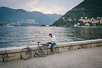 COMO, ITALY - 21 JUNE 2017: A man is seen here as he fishes in Lake Como, in Como, Italy, on June 21st 2017.<br /> <br /> Residents of Como are worried that funds redirected to migrants deprived the town's handicapped of services and complained that any protest prompted accusations of racism.<br /> <br /> Throughout Italy, run-off mayoral elections on Sunday will be considered bellwethers for upcoming national elections and immigration has again emerged as a burning issue.<br /> <br /> Italy has registered more than 70,000 migrants this year, 27 percent more than it did by this time in 2016, when a record 181,000 migrants arrived. Waves of migrants continue to make the perilous, and often fatal, crossing to southern Italy from Africa, South Asia and the Middle East, seeing Italy as the gateway to Europe.<br /> <br /> While migrants spoke of their appreciation of Italy's humanitarian efforts to save them from the Mediterranean Sea, they also expressed exhaustion with the country's intricate web of permits and papers and European rules that required them to stay in the country that first documented them.