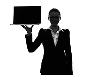 one  business woman holding showing computer laptop in silhouette on white background