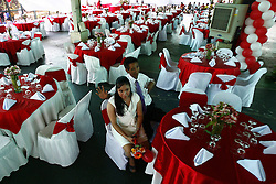 74-year-old Greg Joval, and his 25-year-old wife-to-be May, wait for the start of a Valentine s Day mass wedding in Quezon City, the Philippines, Feb. 14, 2013. About 4000 couples around the Philippines were married in celebration of Valentine s Day, February 14, 2013. Photo by Imago / i-Images...UK ONLY