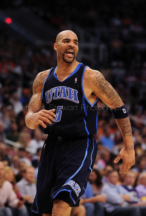 Mar. 19 2010; Phoenix, AZ, USA; Utah Jazz forward Carlos Boozer (5) reacts in the second half at the US Airways Center.  The Suns defeated the Jazz 110-100. Mandatory Credit: Jennifer Stewart-US PRESSWIRE.
