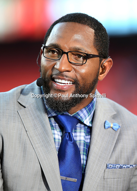 Television football analyst Ray Lewis appears on the ESPN sideline set at the Kansas City Chiefs NFL week 4 regular season football game against the New England Patriots on Monday, September 29, 2014 in Kansas City, Mo. The Chiefs won the game 41-14. ©Paul Anthony Spinelli