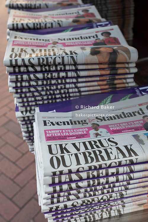 On the day that the UK Government's Chief Scientific Advisor, Sir Patrick Vallance said that the Coronavirus Covid-19 outbreak was now spreading person to person in the UK, the latest news headline from the capital's London Evening Standard newspaper is seen outside Embankment underground station, on 6th March 2020, in London, England.