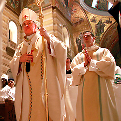 Archbishop Robert J. Carlson processed before Mass observing the 3rd Annual Fortnight for Freedom at the Cathedral Basilica of St. Louis. Processing with the archbishop was Rev. Mr. David M. Miloscia, a transitional deacon serving St. Paul Parish in Fenton.