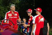 September 3-5, 2015 - Italian Grand Prix at Monza: Sebastian Vettel (GER), Ferrari, Kimi Raikkonen (FIN), Ferrari, Maurizio Arrivabene, team principal of Scuderia Ferrari