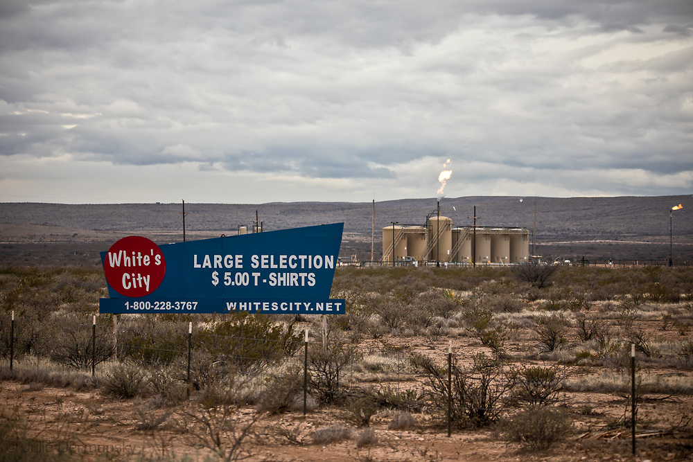 The view greeting tourists as they make their way to the Carlsbad Caverns National Park in New Mexico, where the landscape is now populated with flaring from oil and gas industry sites.