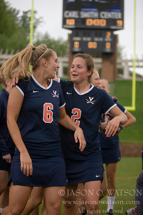 Virginia Cavaliers M Molly Millard (6) and Virginia Cavaliers M Blair Weymouth (2) celebrate their third consecutive Atlantic Coast Conference championship.  The #3 ranked Virginia Cavaliers defeated the #2 ranked Maryland Terrapins 10-9 in overtime in the finals of the Women's 2008 Atlantic Coast Conference Lacrosse tournament at the University of Virginia's Scott Stadium in Charlottesville, VA on April 27, 2008.