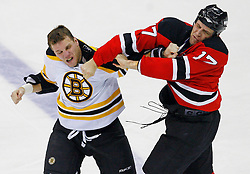 Dec 23, 2008; Newark, NJ, USA; New Jersey Devils left wing Mike Rupp (17) and Boston Bruins left wing Shawn Thornton (22) fight during the second period at the Prudential Center.