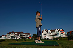 Jens Volders, 8 tees-off on the mini-golf course in Knokke-Zoute. The Volders live in Antwerp but have a family home in Knokke which they use for holidays. (Photo © Jock Fistick)