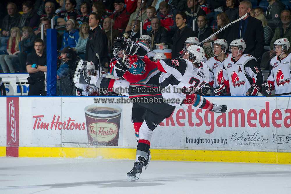 KELOWNA, CANADA - NOVEMBER 30: Carter Rigby #11 of the Kelowna Rockets collides with Spencer Morse #32 of the Moose Jaw Warriors at the Kelowna Rockets on November 30, 2012 at Prospera Place in Kelowna, British Columbia, Canada (Photo by Marissa Baecker/Getty Images) *** Local Caption ***