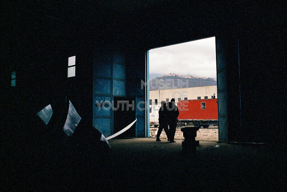 Two men inside a warehouse at Napoli NYE Tek New Years Eve party in Naples, Italy, December 2014