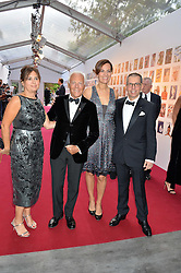 Left to right, ALEXANDRA SHULMAN, GIORGIO ARMANI, his niece ROBERTA ARMANI and JONATHAN NEWHOUSE at British Vogue's Centenary Gala Dinner in Kensington Gardens, London on 23rd May 2016.