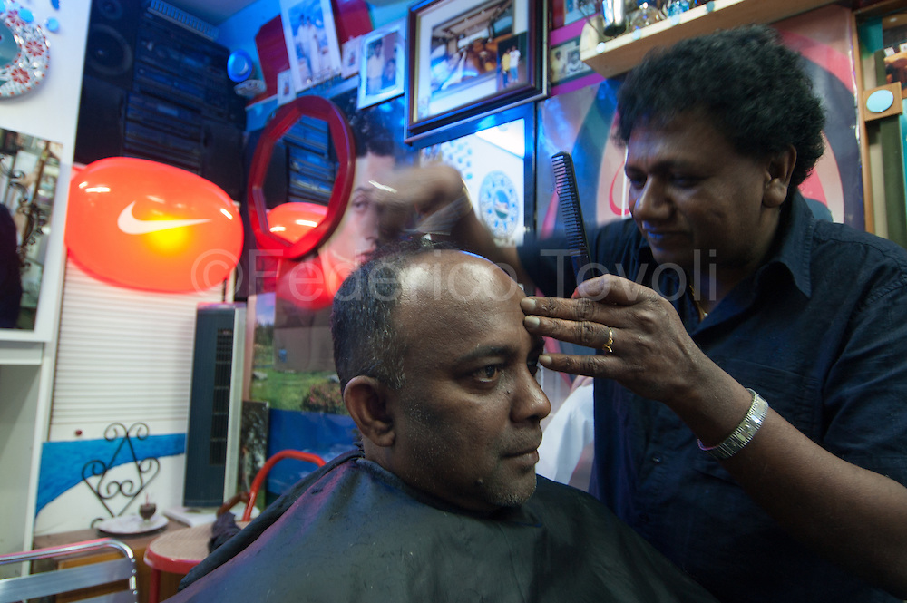A Sri Lankan barber shop in the historic center of Naples.