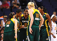 Sep 17, 2011; Phoenix, AZ, USA; Seattle Storm guard Sue Bird (10) , guard Tanisha Wright (30) , forward Swin Cash (2) , forward Camille Little (20), and forward Lauren Jackson (15) talk on the court while playing against the Phoenix Mercury during the first half at the US Airways Center.  Mandatory Credit: Jennifer Stewart-US PRESSWIRE