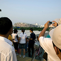 BEIJING, JULY-14 : Tourists try to get a glimpse of the Birds's Nest  24 days before the launch of the  Olympic Games.