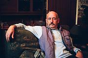 RIchard inside his BL8 prefab, Redditch. Post-war prefabs in Redditch, UK 2003