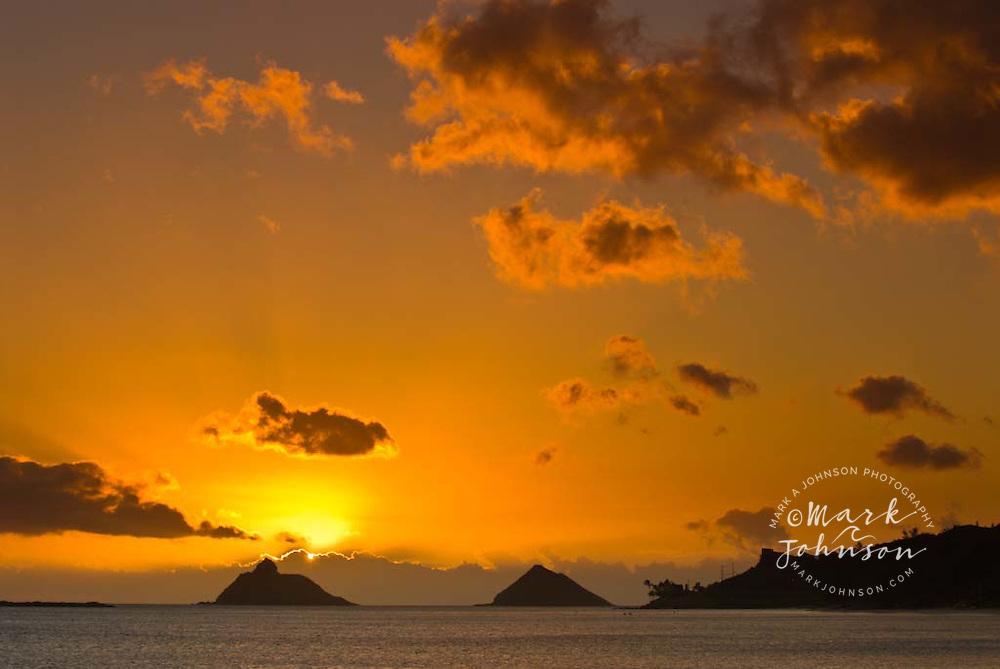 Sunrise behind the Mokolua Islands, Kailua Bay, Oahu, Hawaii