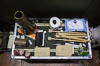 SLIEMA, MALTA - 8 FEBRUARY 2016: Tissues and props of the touring Hamlet, performed by the Shakespeare's Globe theatre company, are here on a trunk in the backstage of the Salesian Theatre in Sliema, Malta, on February 8th 2016.<br /> <br /> The touring Hamlet, performed by the Shakespeare's Globe theatre company, is part of the Globe to Globe tour that set off in April 2014 (on the 450th anniversary of Shakespeare's birth) with the ambitious intention of visiting every country in the world over 2 years. The crew is composed of a total of sixteen men and women: four stage managers and twelve twelve actors  actors perform over two dozen parts on a stripped-down wooden stage. So far Hamlet has been performed in over 150 countries, to more than 100,000 people and travelled over 150,000 miles. The tour was granted UNESCO patronage for its engagement with local communities and its promotion of cultural education. Hamlet was also played for many dsiplaced people around the world. It was performed in the Zaatari camp on the border between Syria and Jordan, for Central African Republic refugees in Cameroon, and for Yemeni people in Djibouti. On February 3rd it was performed to about 300 refugees in Calais at the camp known as the Jungle.