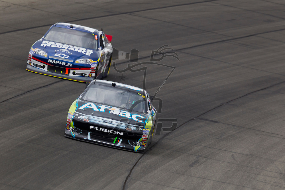 KANSAS CITY, KS - APR 22, 2012:  Carl Edwards (99) races during the STP 400 at the Kansas Speedway in Kansas City, KS.