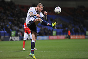 Bolton Wanderers defender, David Wheater (31) clears the ball in the final seconds of the Sky Bet Championship match between Bolton Wanderers and Charlton Athletic at the Macron Stadium, Bolton, England on 19 April 2016. Photo by John Marfleet.