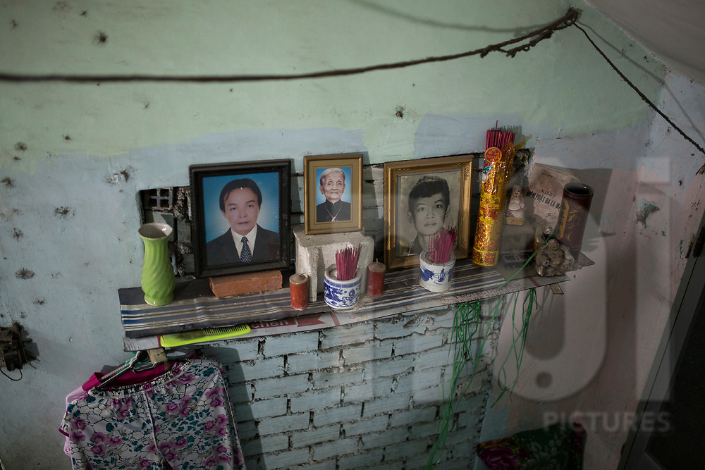 Ancestors altar in a dwelling of  a low-income neighbourhood, Ho Chi Minh City, Vietnam, Southeast Asia