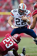 FAYETTEVILLE, AR - OCTOBER 31:  Trent Garland #22 of the UT Martin Skyhawks is hit by Dre Greenlaw #23 of the Arkansas Razorbacks at Razorback Stadium on October 31, 2015 in Fayetteville, Arkansas.  The Razorbacks defeated the Skyhawks 63-28.  (Photo by Wesley Hitt/Getty Images) *** Local Caption *** Trent Garland; Dre Greenlaw