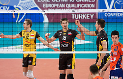 Pawel Zatorski, Michal Bakiewicz of Belchatow vs Milan Rasic of ACH during volleyball match between ACH Volley LJUBLJANA and  PGE Skra Belchatow (POL) of 2012 CEV Volleyball Champions League, Men, League Round in Pool F, 4th Leg, on December 20, 2011, in Arena Stozice, Ljubljana, Slovenia. (Photo By Grega Valancic / Sportida.com)