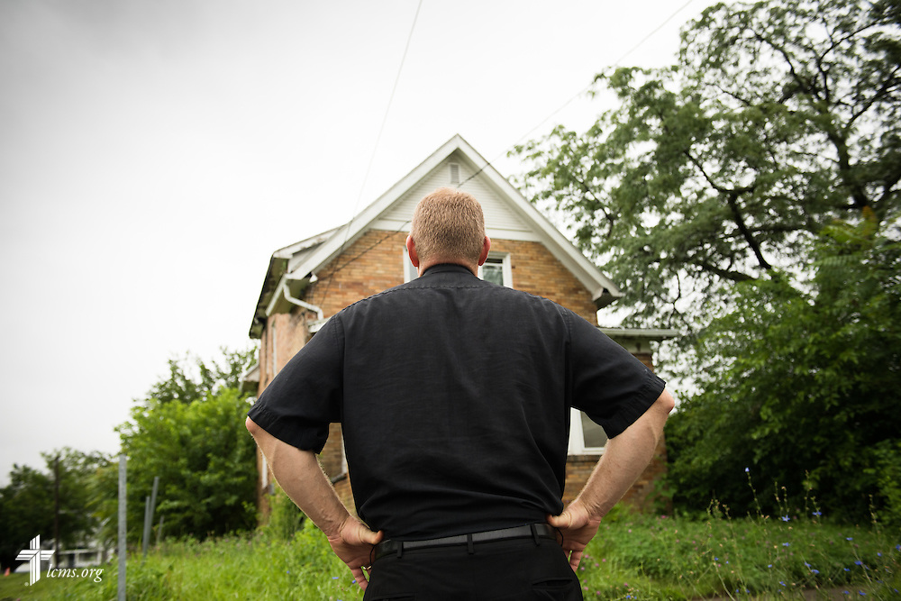 The Rev. Peter M. Burfeind, new domestic missionary and campus pastor at the University of Toledo, surveys a vacant house for a potential new church on Thursday, July 9, 2015, in Toledo, Ohio. LCMS Communications/Erik M. Lunsford