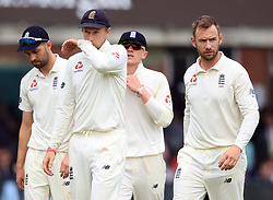 England's Captain Joe Root walks off at the end with his team mates during day four of the First NatWest Test Series match at Lord's, London.