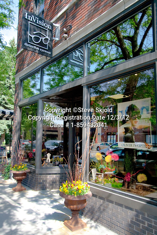 Entry to InVision eyewear or eyeglass shop along charming Grand Avenue. St Paul Minnesota MN USA