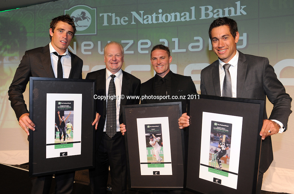 L_R Tim Southee, ANZ National Bank CEO David Hisco, Brendon McCullum and Captain Ross Taylor. 2011 National Bank Cricket Awards held at the Auckland War Memorial Museum in Auckland, New Zealand on Thursday 10 November 2011. Photo: Andrew Cornaga / photosport.co.nz