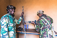Field rangers cleaning weapons, Zakouma National Park, Chad
