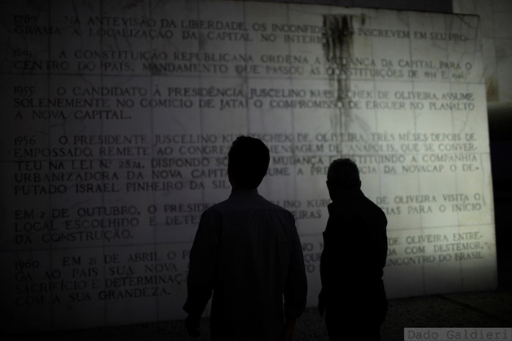 Visitors read inscriptions on a marble monument explaining the history of the creation of Brazil's capital of Brasilia Wednesday, Feb 8, 2012.(Photo Dado Galdieri)