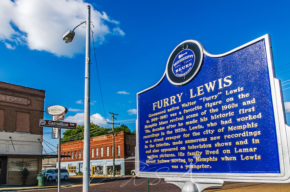 A historic marker erected by the Mississippi Blues Commission commemorates Greenwood native Furry Lewis. In the background is the Crystal Grill. (Photo by Carmen K. Sisson)