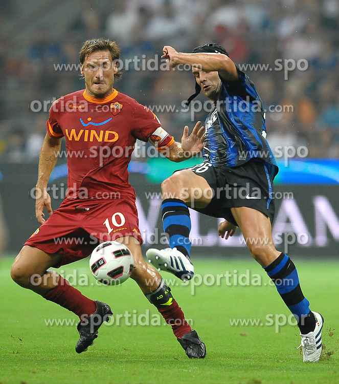 21.08.2010, Stadio Giuseppe Meazza, Mailand, ITA, Supercoppa Italiana 2010., Inter Mailand vs AS Rom, im Bild Francesco TOTTI Roma, Cristian CHIVU Inter.EXPA Pictures © 2010, PhotoCredit: EXPA/ InsideFoto/ Andrea Staccioli +++++ ATTENTION - FOR AUSTRIA AND SLOVENIA CLIENT ONLY +++++... / SPORTIDA PHOTO AGENCY