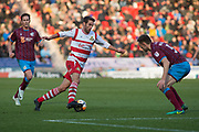 Doncaster Rovers Midfielder Matty Blair (17) during the The FA Cup match between Doncaster Rovers and Scunthorpe United at the Keepmoat Stadium, Doncaster, England on 3 December 2017. Photo by Craig Zadoroznyj.