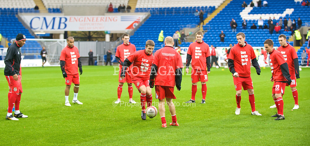 CARDIFF, WALES - Saturday, November 14, 2009: Wales players warm-up wearing 'Show Racism the Red Card' before the international friendly match against Scotland at the Cardiff City Stadium. (Pic by David Rawcliffe/Propaganda)