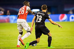 Josip Pivaric #19 of GNK Dinamo Zagreb vs Joel Campbell #28 of Arsenal F.C. during football match between GNK Dinamo Zagreb, CRO and Arsenal FC, ENG in Group F of Group Stage of UEFA Champions League 2015/16, on September 16, 2015 in Stadium Maksimir, Zagreb, Croatia. Photo by Ziga Zupan / Sportida