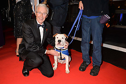 PAUL O'GRADY and Battersea dog Basil at Battersea Dogs & Cats Home's Collars & Coats Gala Ball held at Battersea Evolution, Battersea Park, London on30th October 2014.