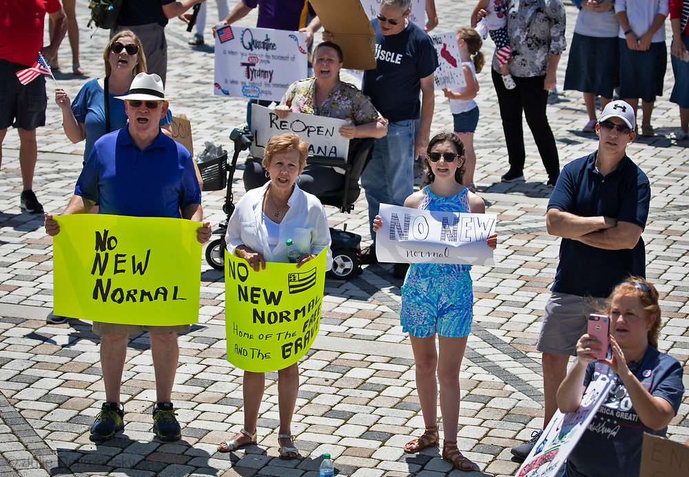 "An 'End the Shutdown"" protest in Baton Rouge. LA on April 25, 2020 in Baton Rouge , Louisiana. A group of a few dozen people who want the restrictions Gov. John Bel Edwards put in place to stop the spread of COVID-19 lifted, held a rally in front of the State Capitol Building on Saterday, before marching to the Governors Mansion where they called on him to end the shut down."