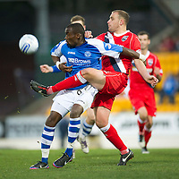 St Johnstone v Ross County...17.11.12      SPL<br /> Gregory Tade is tackled by Grant Munro<br /> Picture by Graeme Hart.<br /> Copyright Perthshire Picture Agency<br /> Tel: 01738 623350  Mobile: 07990 594431