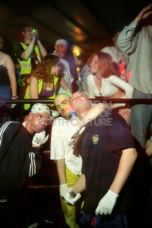 Three guys at a rave one with his arm around the other, 10/5/1997 Hardcore Heaven, Milton Keynes